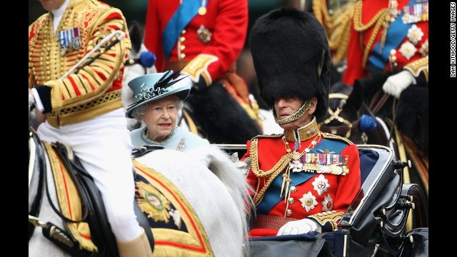 June 11, 2011: Queen Elizabeth II and Prince Philip attend the annual Trooping the Colour ceremony in a horse and carriage.