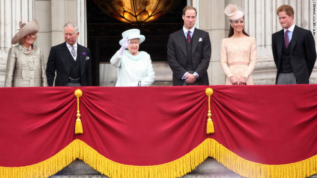 Camilla, Duchess of Cornwall, Prince Charles, Prince of Wales, Queen Elizabeth II, Prince William, Duke of Cambridge, Catherine, Duchess of Cambridge and Price Harry wave to the crowds from Buckingham Palace.