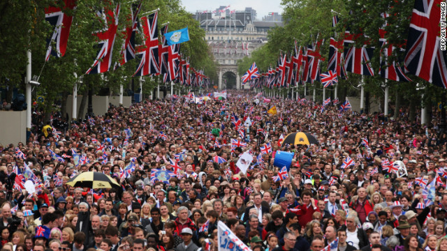 The crowd is escorted down The Mall during the Diamond Jubilee carriage procession after the service of thanksgiving at St.Paul's Cathedral.