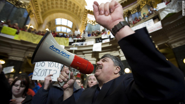 Richard Trumka, national AFL-CIO president, speaks to protesters in the capital rotunda during a rally in opposition to Walker's proposal.