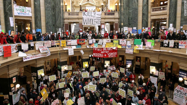 Union members and protesters fill the capitol rotunda in Madison.