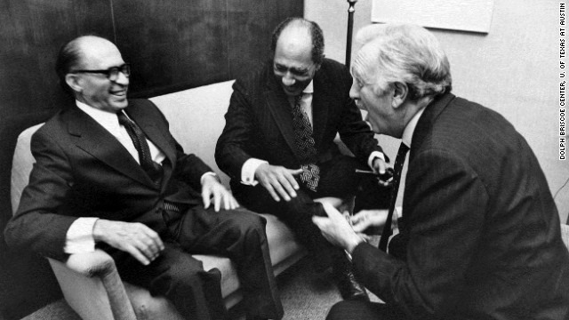 Israeli Prime Minister Menachem Begin and Egyptian President Anwar al-Sadat laugh with Cronkite at the King David Hotel in Jerusalem in November 1977.