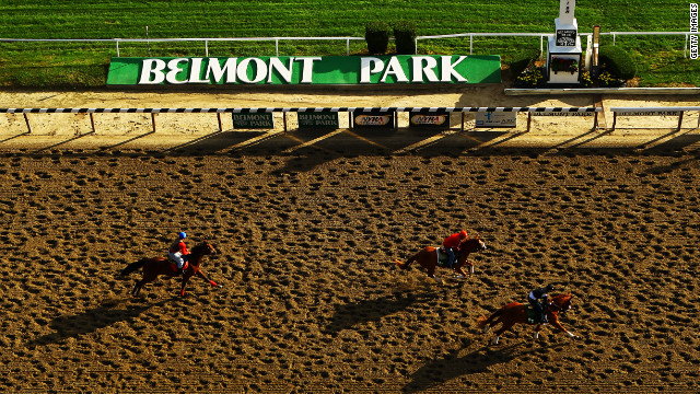 Horses and exercise riders train Tuesday during a morning workout at Belmont Park in Elmont, New York.
