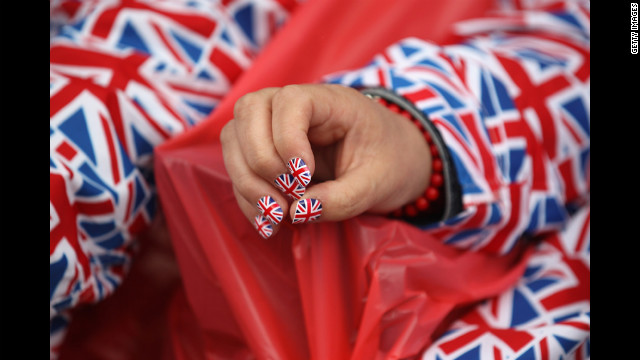 A woman with Union Jack painted nails waits for The Diamond Jubilee Concert to start.