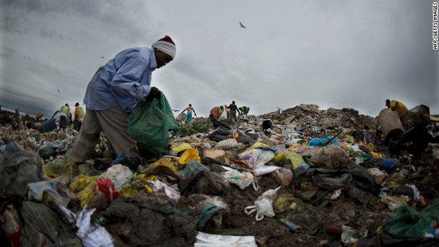 "A <i>catadore</i> sifts through the trash at the Jardin Gramacho landfill site in Rio de Janeiro. The facility was closed in 2012 but featured as the backdrop for the 2010 Oscar nominated movie, ""Wasteland."""