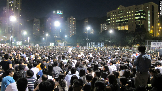 Organizers reported a record 180,000 attendees, spilling out of six football pitches at Victoria Park on Hong Kong Island.