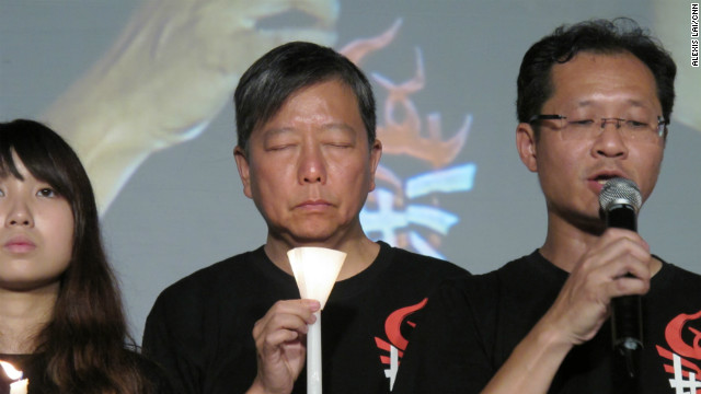 A moment of remembrance is reflected in the face of Andrew Lee Cheuk-yan, chairman of the organizing Hong Kong Alliance in Support of Patriotic Democratic Movements of China.