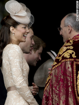 Catherine, Dutchess of Cambridge, smiles as she arrives at St Paul's Cathedral. Thousands of well-wishers crowded against security barriers to welcome all of the arrivals at St Paul's. 