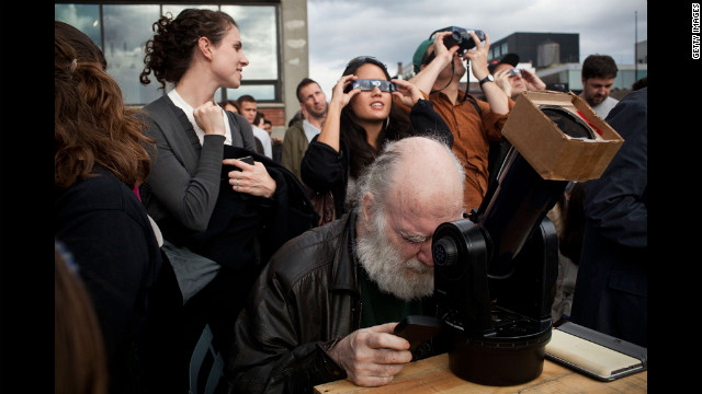 Ray Dobbins of New York uses a telescope to observe the transit of Venus at the High Line park in Manhattan.