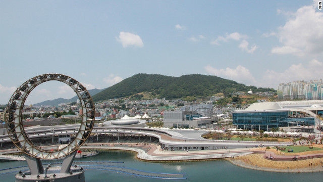 Korean architecture firm Samoo also designed 10 of the Expo's main buildings in Yeosu. The &quot;Big-O&quot; (left) is part of the nightly entertainment display. 