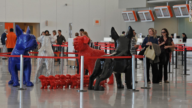 Sculptures by Belgian artist William Sweetlove are displayed at Carrasco airport in Montevideo as part of a temporary exhibition in November 2011.