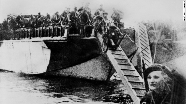 French commandos equipped with bikes disembark from their landing craft after Allied forces stormed the Normandy beaches. Germans rained mortars and artillery down on allied troops, killing many before they could even get out of their boats. Fighting was especially fierce at Omaha Beach, where Nazi fighters nearly wiped out the first wave of invading forces and left the survivors struggling for cover.
