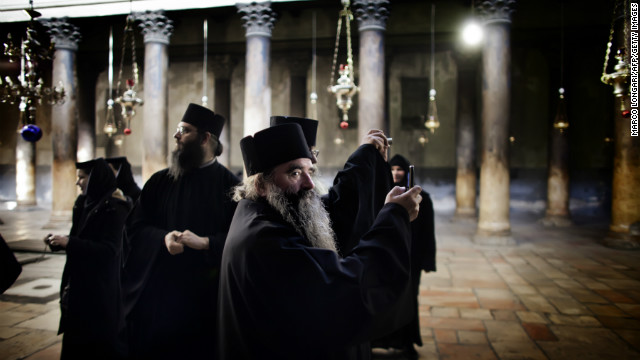 Bethlehem is situated in the West Bank, about eight kilometers south of Jerusalem. Pictured, Orthodox monks tour the church.