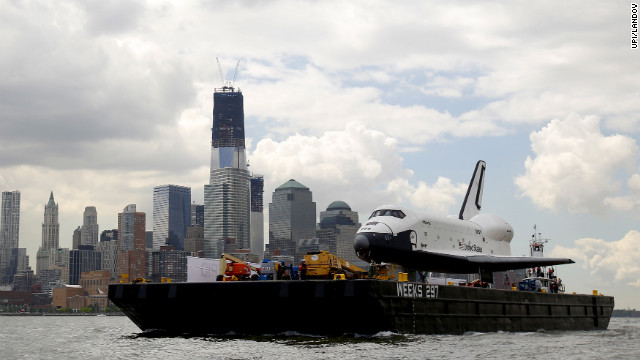 The shuttle passes by the New York skyline on Wednesday.