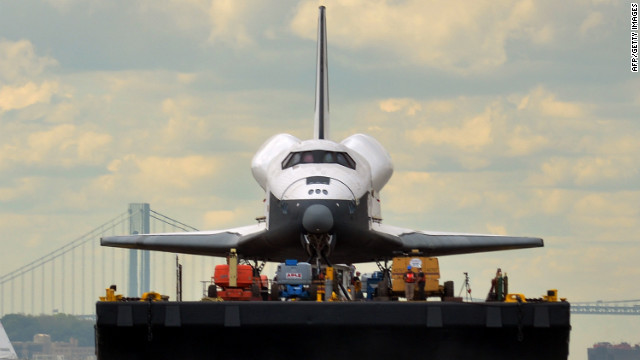 Enterprise floats head-on toward the Intrepid Sea.