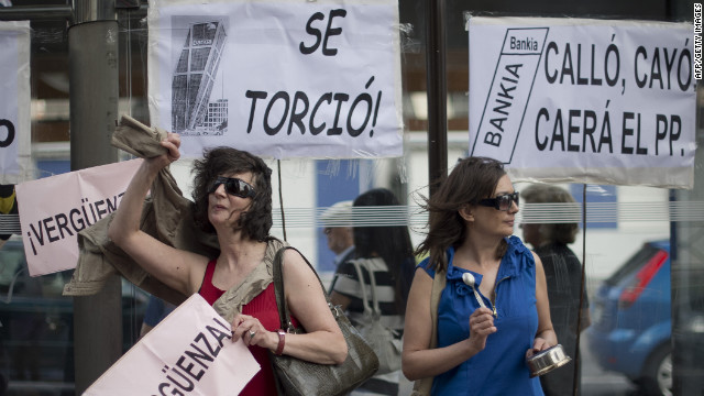People demonstrate against Spain's banking sector in front of Bankia, on June 02, 2012. Bankia asked for 19 billion in aid.
