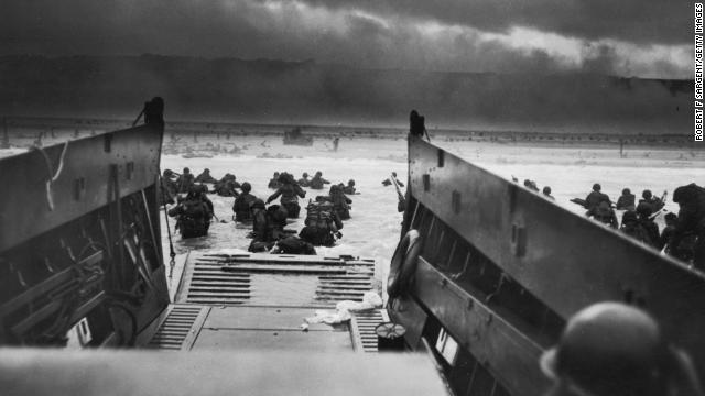 The Allies stormed the beaches of Normandy, France, on June 6, 1944. Here American troops hit the water from one of the landing craft. Soldiers on shore are lying flat under German machine gun fire. Coast Guard photographer Robert F. Sargent took this view from a landing craft.