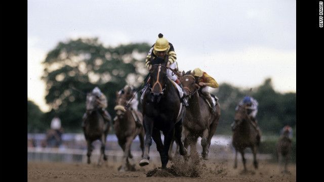 Jockey Jean Cruguet guides Seattle Slew to the Triple Crown at the Belmont Stakes in 1977.