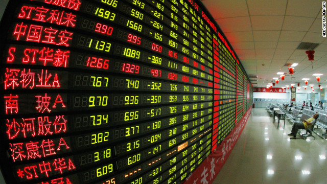 Chinese stock investors monitor their share prices at a stock brokerage firm in Huaibei, east China's Anhui province on June 4, 2012.