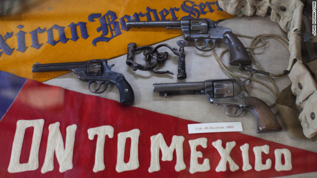 Military artifacts, including pistols and propaganda, are on display at the Pancho Villa State Park Museum in Columbus, New Mexico. Columbus was raided in 1916 by Villa and his army, leaving dozens dead.