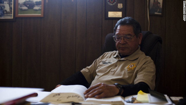Luna County Sheriff Raymond Cobos at his desk in Deming, New Mexico. After Columbus was raided by federal agents and several officials were accused of arms trafficking, the village police department collapsed. The Luna County Sheriff's Department now polices the town and its surrounding area. 