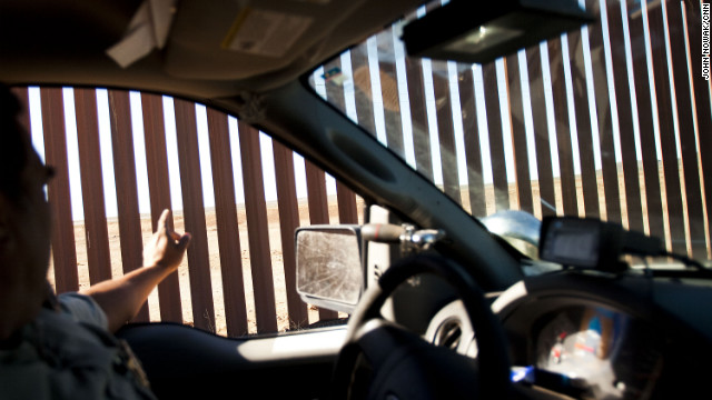 Luna County Sheriff's Department Cpl. Jose Ojeda points to spot across the Mexican border where bodies were dumped by cartels. Columbus' sister city, Puerto Palomas, Mexico, has been plagued by cartel violence.