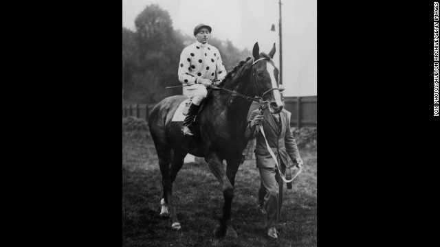 Omaha -- the son of Gallant Fox -- won the Triple Crown in 1935. Here, jockey Pat Beasley rides the horse in 1936.