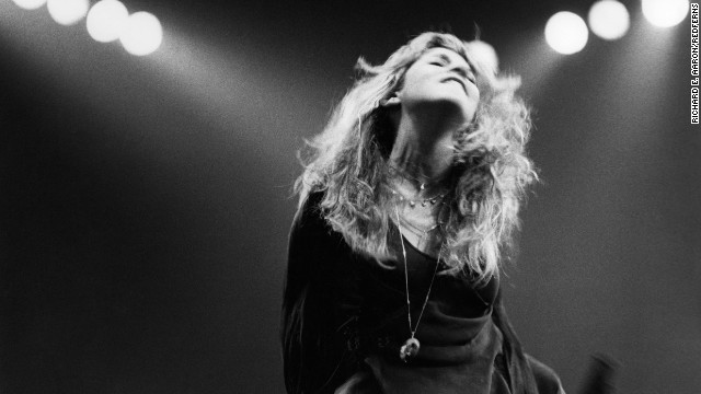 Singer and songwriter Stevie Nicks performs on stage. She joined Fleetwood Mac in 1974 with her then-boyfriend Lindsey Buckingham.
