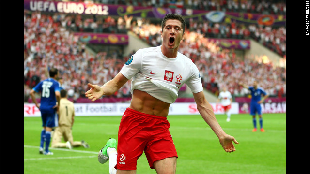 Robert Lewandowski of Poland celebrates scoring the opening goal during the match against Greece.