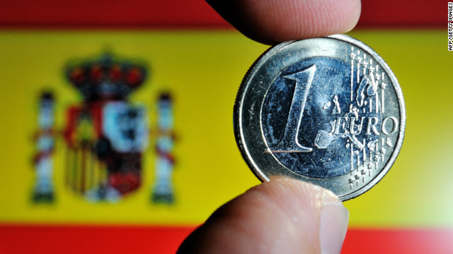 Euro coin and Spanish flag