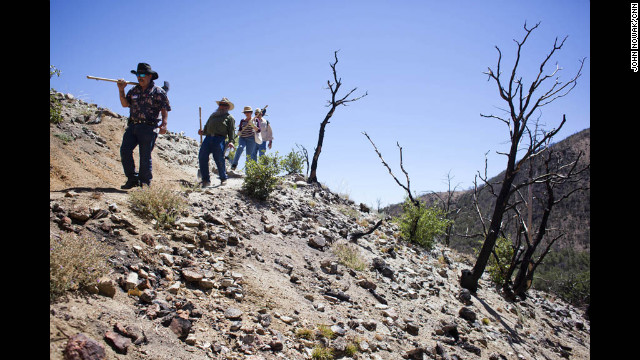 Volunteers hike through Coronado National Forest. About a hundred volunteers joined the Tombstone Shovel Brigade, hiking up the mountain to help move and bury the line that supplies Tombstone with water.