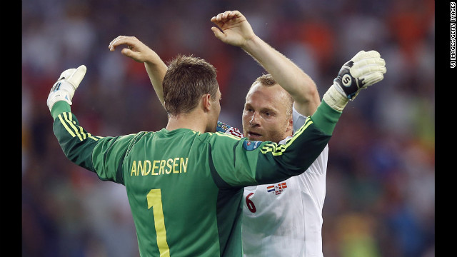 Goalkeeper Stephan Andersen of Denmark celebrates with teammate Lars Jacobsen during the match against the Netherlands.
