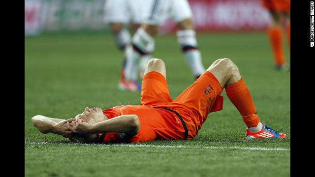 Arjen Robben lies dejected on the pitch after the Netherlands' loss to Denmark on Saturday.