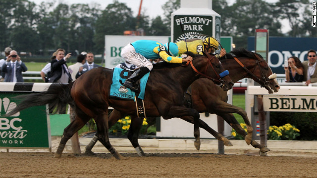 Union Rags, ridden by John Velazquez edges past Paynter, ridden by Mike Smith, to win the Belmont Stakes.