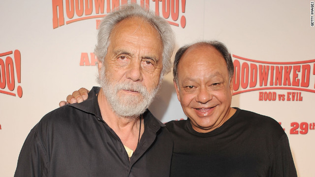 Tommy Chong, left, poses with comedy teammate Cheech Marin at an appearance in April 2011.