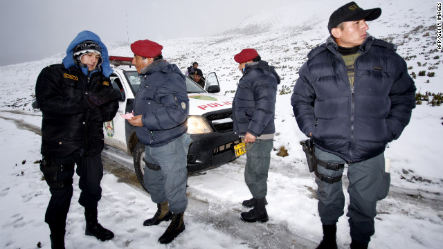 A police team joins in rescue operations in last week's crash of a helicopter in a remote, mountainous area of Peru.