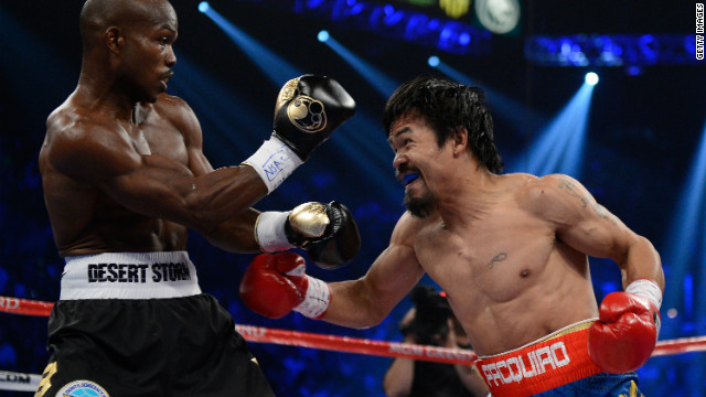 Manny Pacquiao prepares to throw a left to the head of Timothy Bradley during their WBO welterweight title fight at MGM Grand Garden Arena on June 9, 2012 in Las Vegas, Nevada.