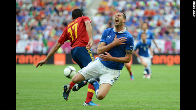 Thiago Motta of Italy takes a fall while playing against Spain on Sunday.