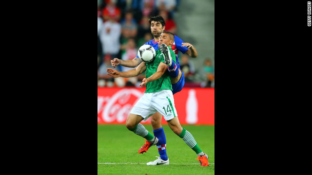 Ireland's Jonathan Walters competes with Croatia's Vedran Corluka.