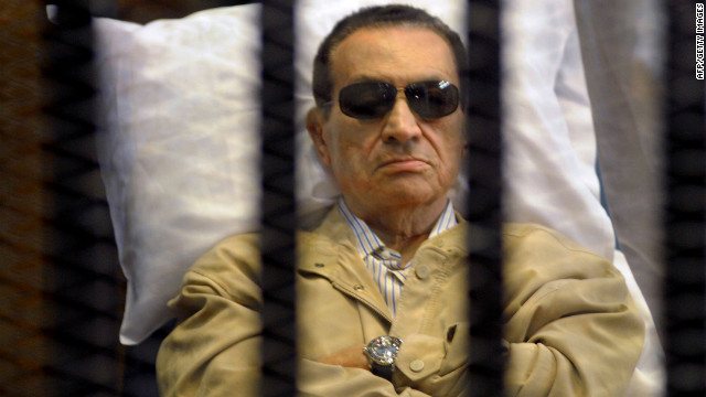 Ousted Egyptian president Hosni Mubarak sits inside a cage in a courtroom during his verdict hearing in Cairo on June 2, 2012. 