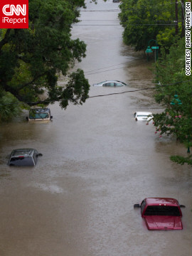 CNN iReporter Randy Hamilton found cars nearly covered by floodwaters Saturday in Pensacola. Some places in Alabama and Florida received up to nearly 2 feet of rain, including 21.7 inches in West Pensacola.