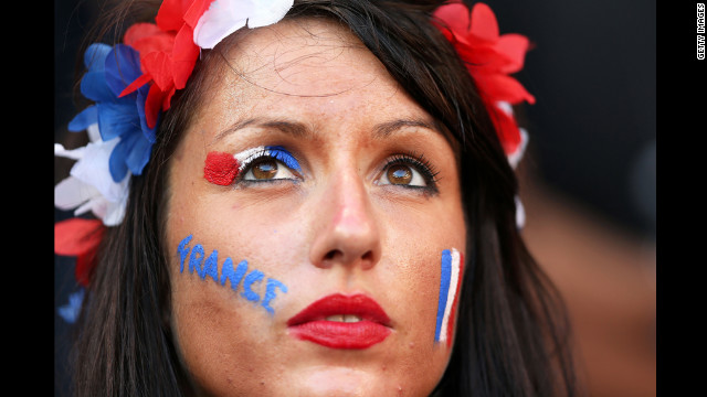 A France fan shows her colors during the game against England.