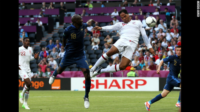 Joleon Lescott of England scores during the first half of the match against France.