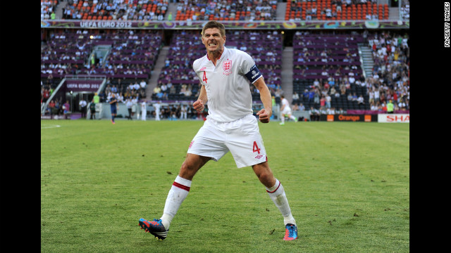 Steven Gerrard of England celebrates after Joleon Lescott's goal against France.