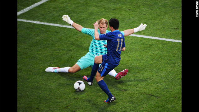 Goalkeeper Joe Hart of England blocks Samir Nasri of France during the Group D match in Donetsk, Ukraine, Monday, June11.