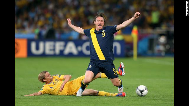 Ukraine's Anatoliy Tymoshchuk tackles Kim Kallstrom of Sweden.