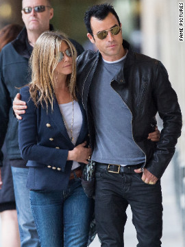 Jennifer Aniston and Justin Theroux roam around Paris.