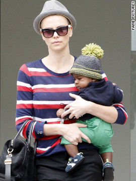 Charlize Theron walks around Beverly Hills with her son.