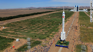 The Shenzhou-9 spacecraft and its carrier rocket as seen Saturday in northwest China\'s Gansu province.