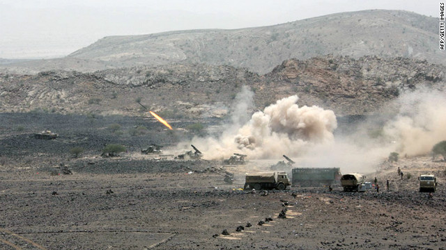 A rocket is fired by the Yemeni army during a military operation against al Qaeda in Loder, in the southern Abyan province, on June 10, 2012.